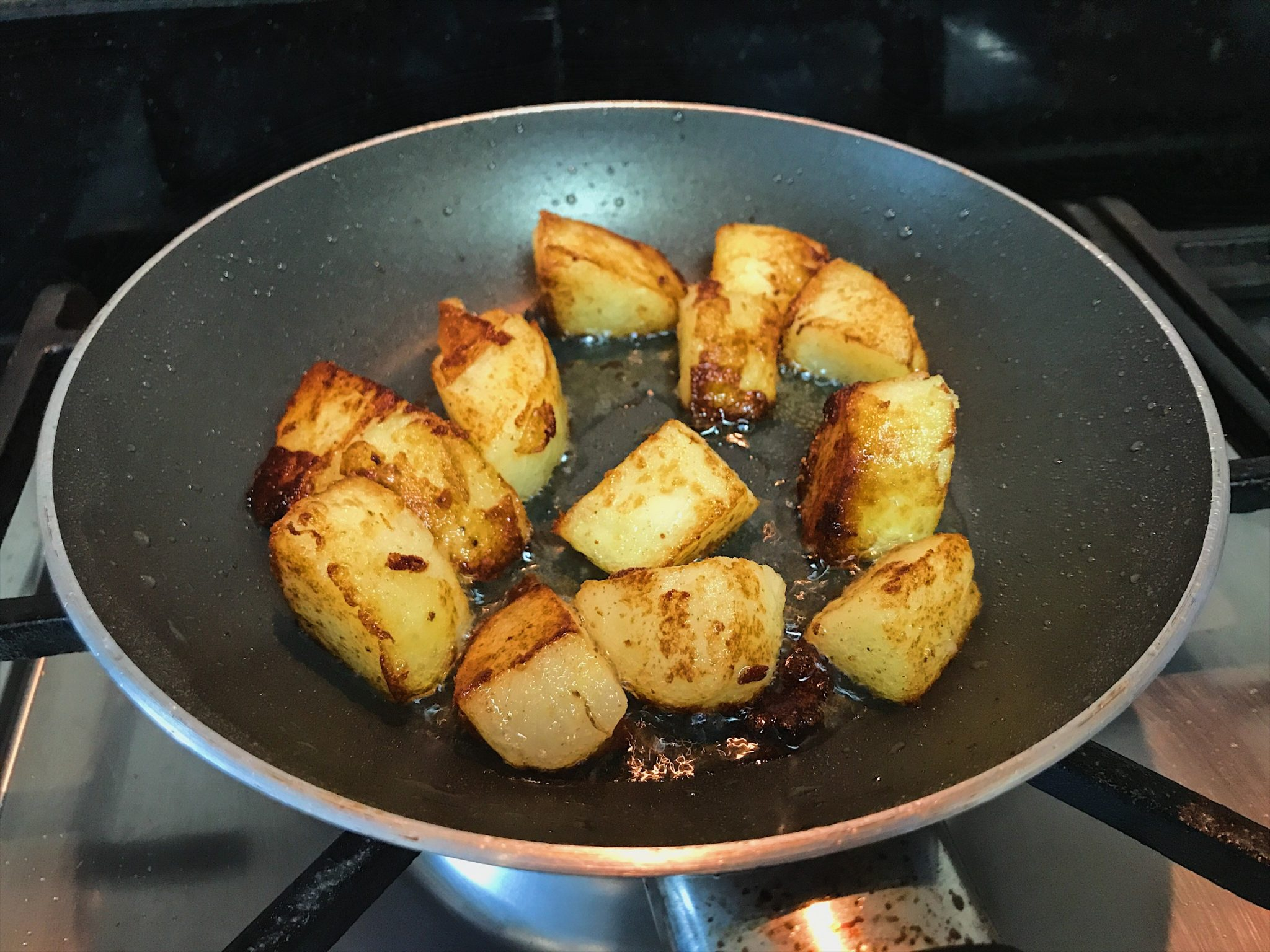 Frying boiled potatoes for Aloo Chaat