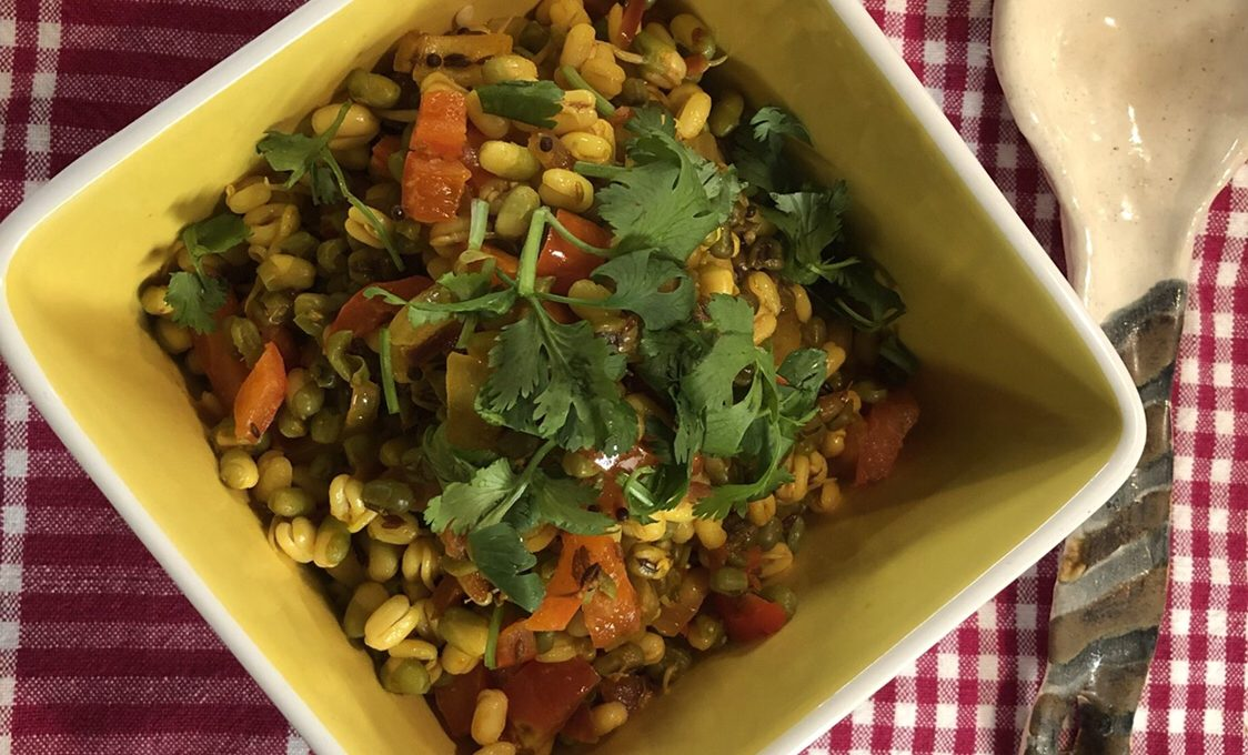 Bowl of moong sprouts with a simple tadka.