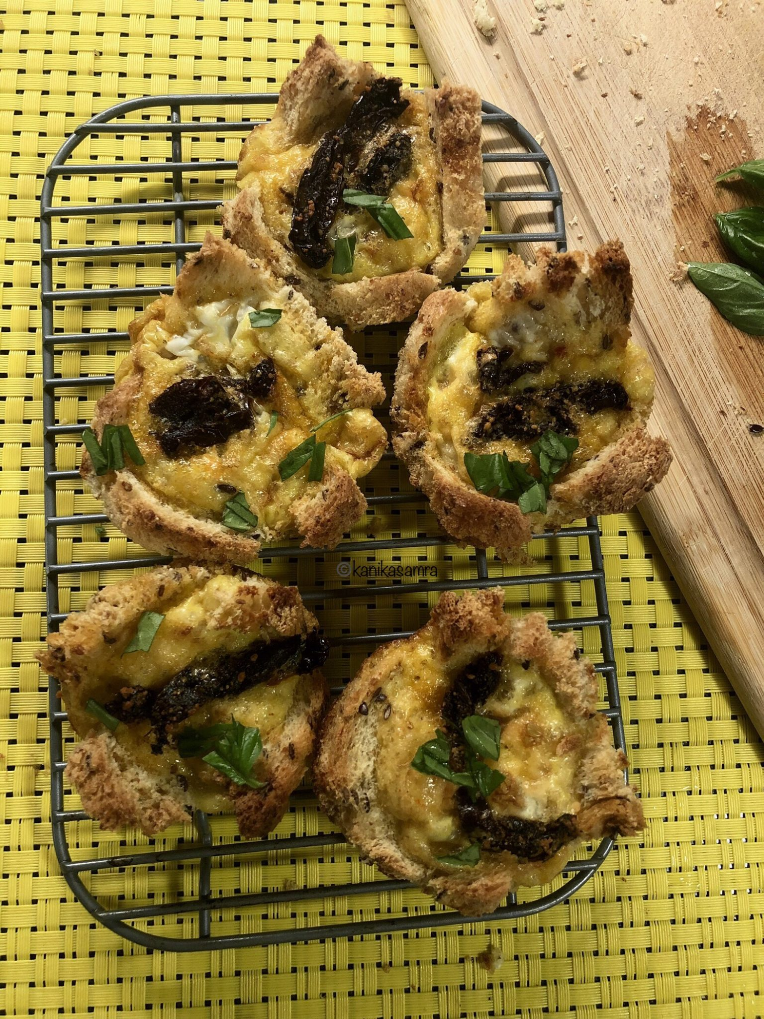 Breakfast Muffins with eggs, sun-dried tomatoes, bread and basil.