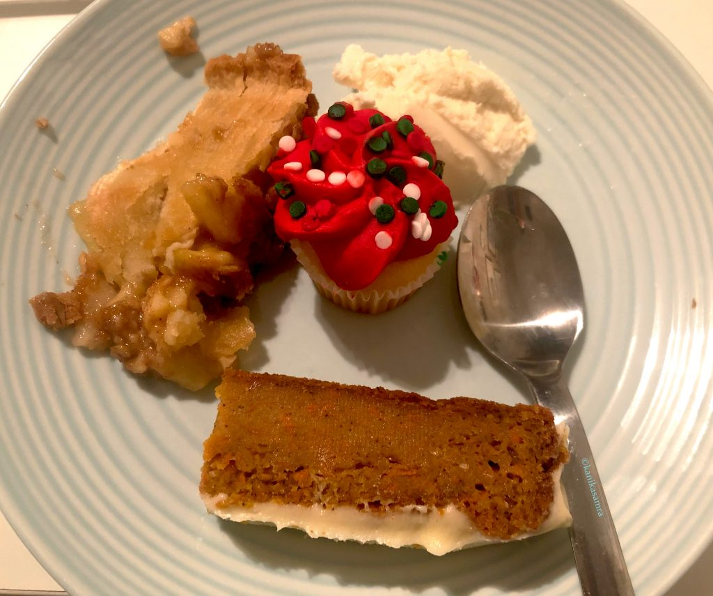 Desserts on a plate with rum soaked carrot cake.