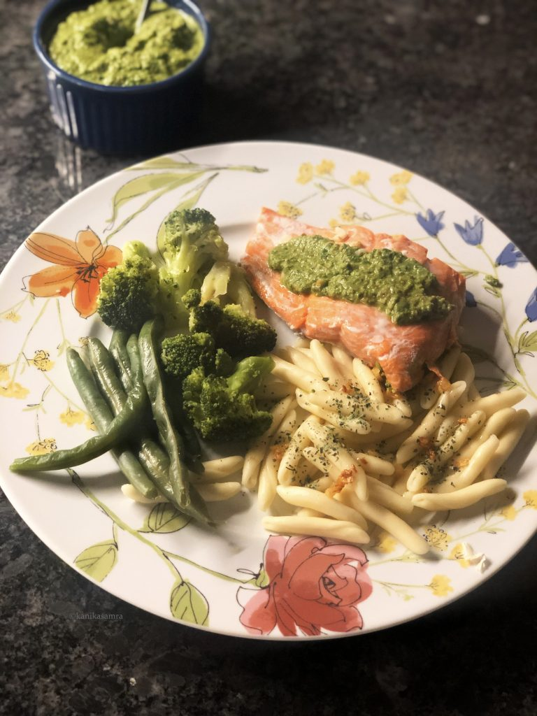 Steamed salmon with pasta and pesto.