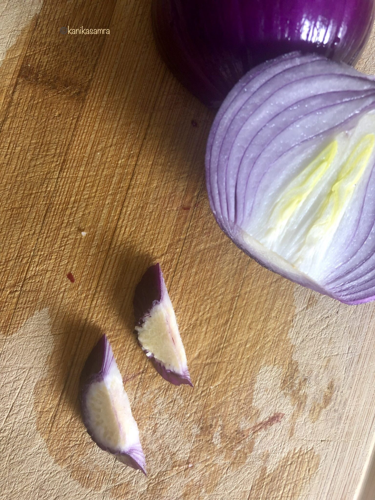 Red onion being sliced