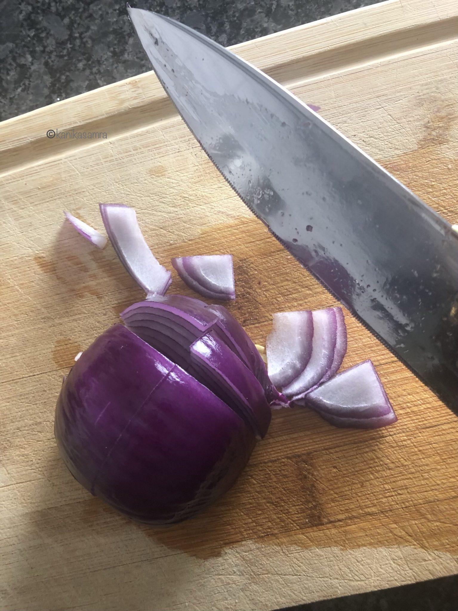 Chopping an onion half