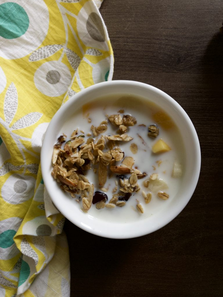 Granola in milk with fruits